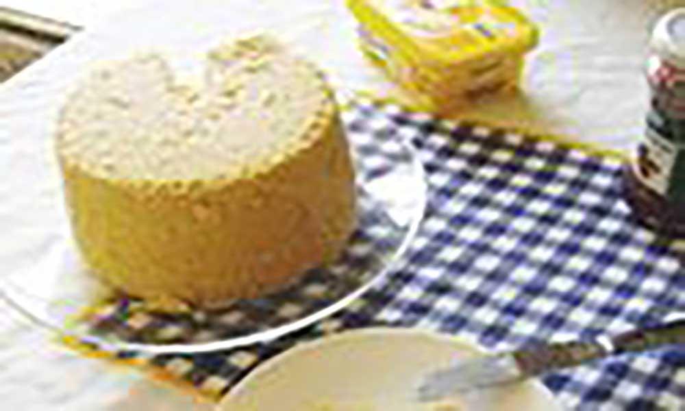 Cuscuz de farinha de milho com mel de cana